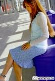 Голубая меланжевая юбка с оборкой, связанная спицами. Описание и схемы вязания бесплатно