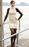 Платье сливочного цвета, связанное спицами. Описание вязания и выкройки бесплатно