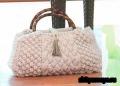 Серая сумка, связанная спицами. Описание и схемы вязания бесплатно