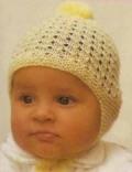 Желтая детская шапочка, связанная спицами. Подробное описание