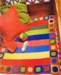 Детский полосатый коврик, связанный крючком. Описание + схема