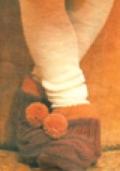 Детские домашние тапочки-башмачки, связанные спицами
