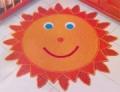 Желто-оранжевый детский коврик-солнышко, связанный крючком. Описание + схема