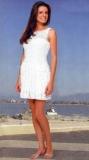 Белое летнее платье с вертикальными оборками, связанное крючком. Описание + схемы