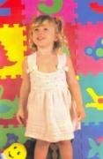 Розовый сарафан на девочку 1-2 года, связанный спицами. Подробное описание