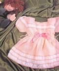 Розовое платье на девочку на 1-2 года, связанное спицами. Подробное описание