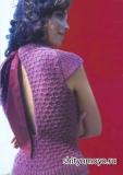 Кофточка, связанная спицами, с бантом на спине