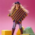Детское разноцветное пончо, связанное крючком. Описание и схемы бесплатно